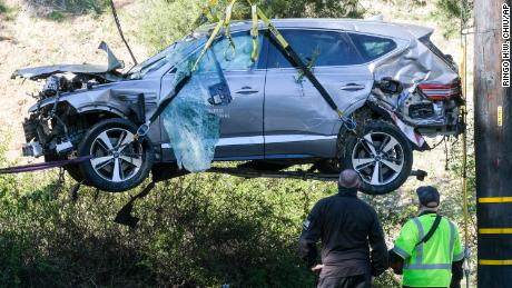 A crane lifts the SUV Tiger Woods was driving that crashed on February 23 in the Rancho Palos Verdes suburb of Los Angeles.