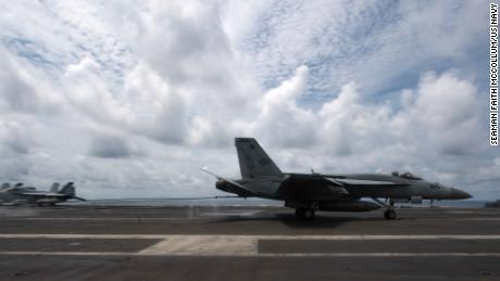 A US Navy F/A-18E Super Hornet lands on the flight deck of the aircraft carrier USS Theodore Roosevelt on April 5, 2021, during operations in the South China Sea.