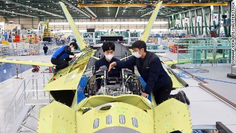 A handout photo released by KAI shows workers of Korea Aerospace Industries (KAI) assemble the first prototype of South Korea's indigenous fighter jet at its plant in the southeastern city of Sacheon, South Korea in January.