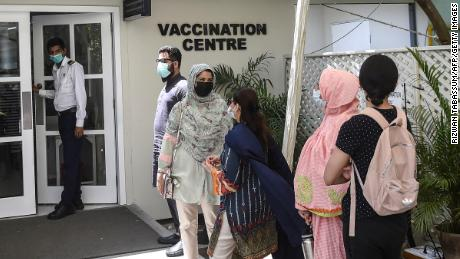 People wait to receive a dose of Russia's Sputnik V vaccine in Karachi, Pakistan, on April 5.