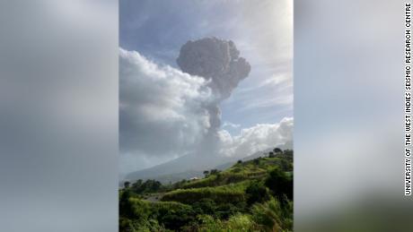 Ash rises as an explosive eruption begins at La Soufrière volcano in St. Vincent on Friday.
