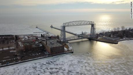 Lake Superior contains roughly 10% of world's accessible drinking water and is the largest of the Great Lakes. The Aerial Lift Bridge raises for ships entering the harbor from Lake Superior.