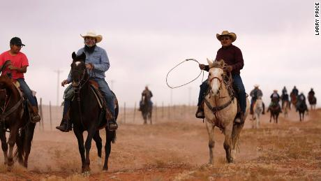 Voters traveling on horseback from El Capitan to Kayenta, Arizona, to cast their ballots on Election Day for the 2020 presidential election as part of the Ride to the Polls campaign.