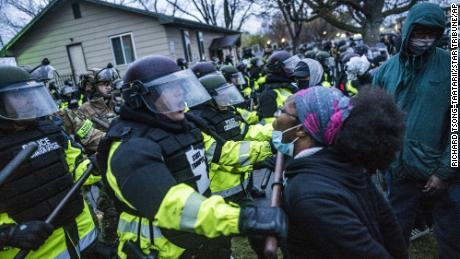 Police fire tear gas at protesters in a second night of demonstrations after Minnesota officer fatally shoots Black man