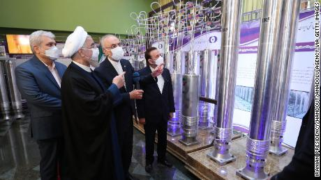 Iran's President Hassan Rouhani (L) visits Nuclear Technology exhibition in Tehran, Iran on April 10, 2021.