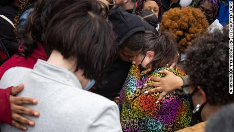 Katie Wright, center, the mother of Daunte Wright, is embraced by family members and the girlfriend of George Floyd at a news conference outside the Hennepin County Government Center in Minneapolis on Tuesday.