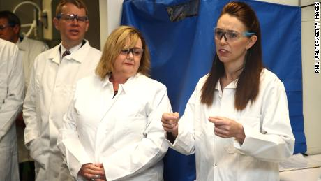 New Zealand Prime Minister Jacinda Ardern (right) and Megan Woods, Minister of Research, Science and Innovation, visit a lab at Auckland University.