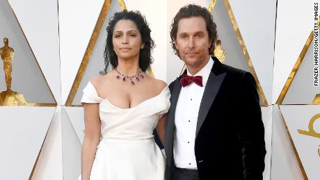 HOLLYWOOD, CA - MARCH 04: Matthew McConaughey (L) and Camila Alves attend the 90th Annual Academy Awards at Hollywood & Highland Center on March 4, 2018 in Hollywood, California.