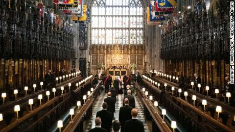 Members of the royal family follow Prince Philip's coffin into St. George's Chapel.