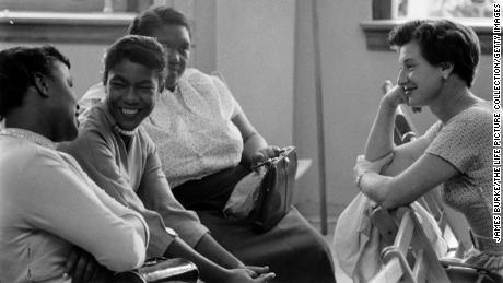 Parents of students in a newly integrated classroom talking after school in 1956 in Louisville, Kentucky.