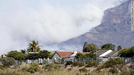 Heavy smoke rises from Table Mountain in Cape Town.