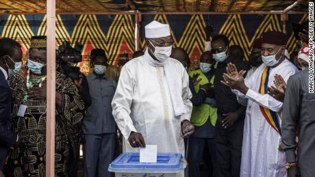 Chadian President Idriss Deby Itno (C) casts his ballot at a polling station in N'djamena, on April 11, 2021.