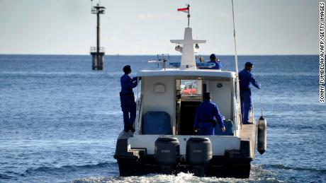 Indonesian marine police take part in the search operation for the missing naval KRI Nanggala-402 submarine on Thursday.