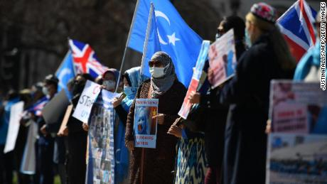 Members of the Uyghur community urge the British Parliament to vote to recognize alleged persecution of China's Muslim minority Uyghur people as genocide and crimes against humanity in London on April 22, 2021.