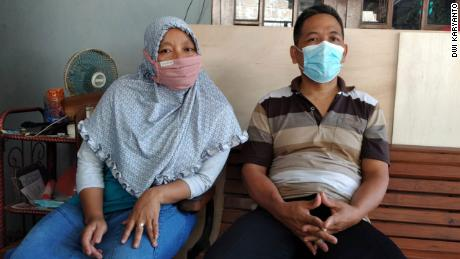 Sumiyati, left, and Sunaryo await news of their son, Gunadi Fajar Rahmanto, who is one of the crew members on the missing submarine, at their home in Yogyakarta, Indonesia, on April 24.