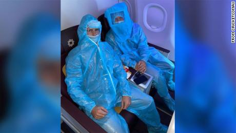 Australian cricketers wear full PPE on flight to Delhi; Aussie PM tells IPL stars to make 'own arrangements' to return home