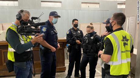 Newly graduated officers and veterans of the force go through a live-action role play of a distress call to train for de-escalation techniques.