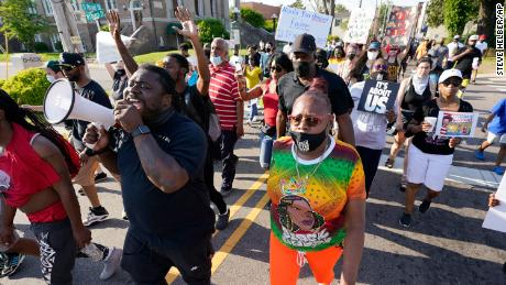 Demonstrators march along the streets to protest the shooting of Brown Jr. in Elizabeth City.