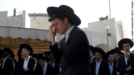 As families bury their dead, recriminations begin over deadly crush at a religious festival in Israel