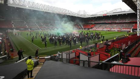 Supporters protest against Manchester United's owners, inside the club's Old Trafford stadiumon May 2, 2021, ahead of their English Premier League fixture against Liverpool.