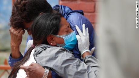 Nepal's cases skyrocket, prompting concern the country's outbreak could mimic India's