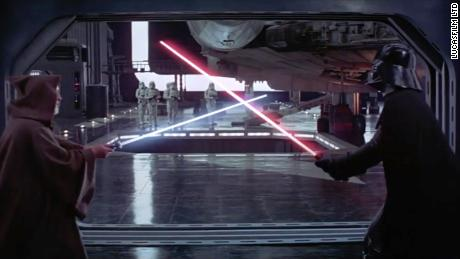 """(From left) Sir Alec Guiness as Obi-Wan Kenobi battles David Prowse as Darth Vader in """"Star Wars: Episode IV - A New Hope."""""""