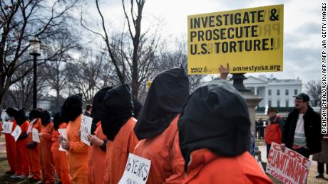 Protesters call for the closure of the Guantanamo Bay detention camp during a rally in Washington DC in January 2018.