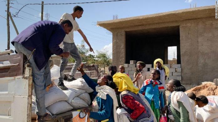 USAID distributes supplies to residents in the town of Hawzen, in central Tigray, who hadn't received much-needed aid for two months.