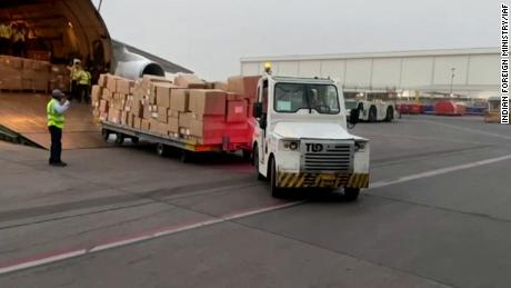 Foreign aid supplies are unloaded from planes at the airport in New Delhi, India on April 29.