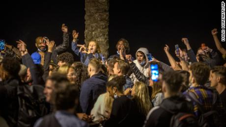 People dance on the beach in Barcelona. Spain is relaxing overall measures to contain the coronavirus this weekend, allowing residents to travel across regions.