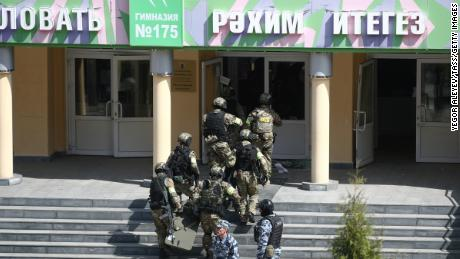 FSB officers by school No. 175, where two attackers opened fire on Tuesday.