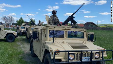 Humvees and troops prepare to join a military training with US, Ukrainian and Romanian special forces in Reghin, Romania.