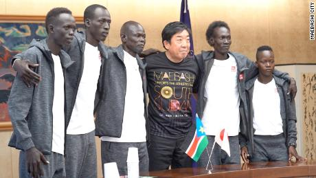The mayor of Maebashi posing with the South Sudan Olympic team.
