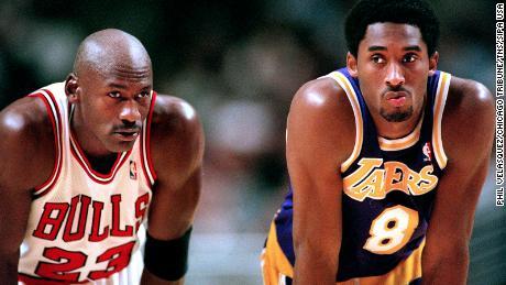 Jordan talks to Bryant during free throws in 1997.