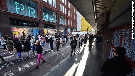 Thousands of shoppers wait for Primark to open for the first time since the latest lockdown on April 30, 2021 in Belfast, Northern Ireland.