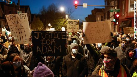 Protesters march through Logan Square neighborhood during a protest on April 16, 2021, over the killing of 13-year-old Adam Toledo.