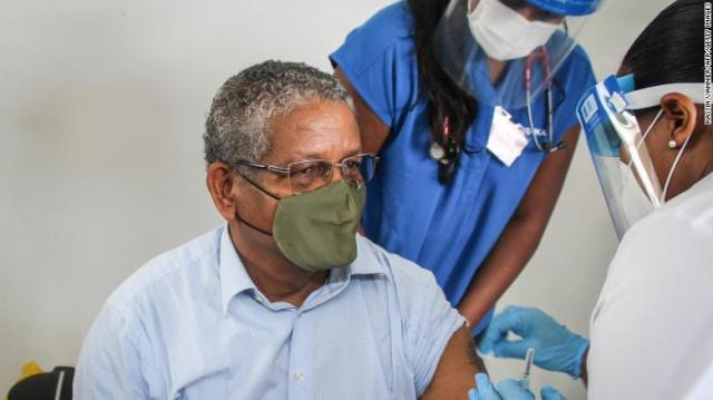 President of Seychelles Wavel Ramkalawan receives the first dose of the Covid-19 vaccine at the Seychelles Hospital in Victoria on January 10, 2021.