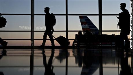 Travelers walk through Ronald Reagan National Airport in Washington, D.C.