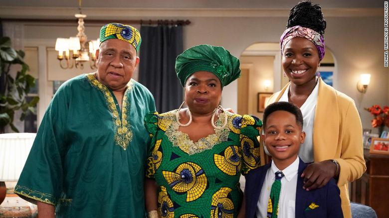 On the show, Abishola and her son live with her Nigerian aunt and uncle in Detroit, Michigan. Pictured (L-R): Barry Shabaka Henley as Uncle Tunde, Shola Adewusi as Auntie Olu, Travis Wolfe, Jr. as Dele, and Olowofoyeku as Abishola.