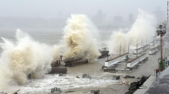 Waves lash over onto a shoreline in Mumbai on May 17 as Cyclone Tauktae bears down on India.