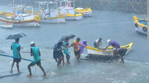 Fishermen pull their boats as Cyclone Tauktae approaches at Worli village, Mumbai, India, on May 17.
