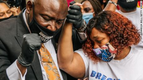 Attorney Ben Crump and Tamika Palmer, mother of Breonna Taylor, on September 15, 2020 in Louisville, Kentucky. The city of Louisville had just announced it will institute police reforms and pay $12 million to the family for the killing of Breonna Taylor, who was fatally shot by Louisville police officers during a no-knock raid at her apartment on March 13, 2020.