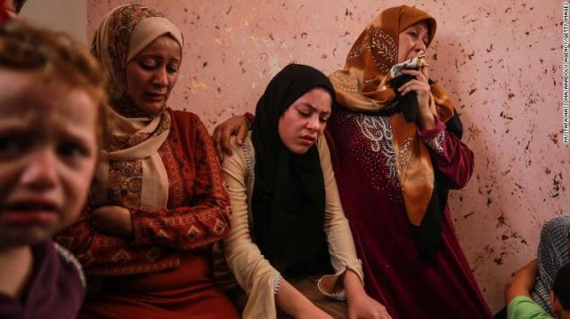 Relatives of 11-year-old Deema Asaliyeh, who was killed in an Israeli strike, mourn during her funeral ceremony at Jabalia refugee camp in Beit Lahia, Gaza on Thursday.