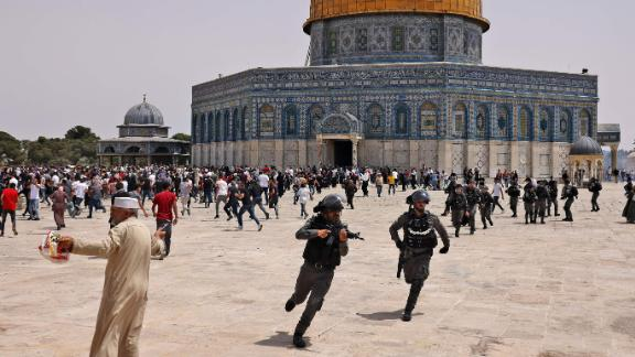 Israeli security forces and Palestinian worshipers clash in the Al Aqsa mosque compound in Jerusalem on Friday.
