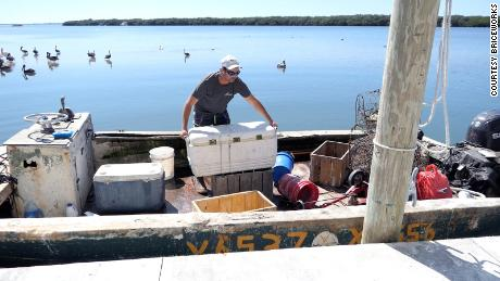 The man shown in the photo with the cooler in the boat is Jacob Reeder. The photo was taken in Cortez, at the AP Bell Fish Co. boat docks. That's the company that Karen Bell owns.