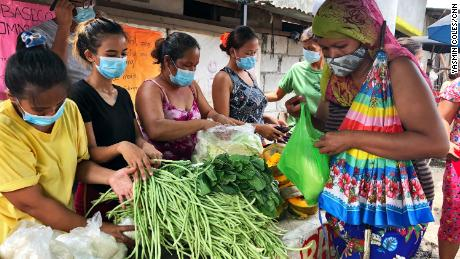 Community kitchens rely on donations to help feed hungry people in Manila.