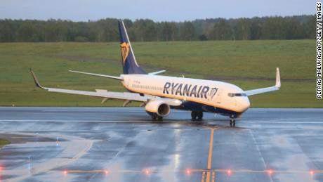 The Ryanair flight was allowed to resume its journey to Vilnius after two dissidents were removed from the plane.