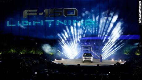 Ford's Chief Executive Engineer Linda Zhang unveils the Ford F-150 Lightning in Dearborn, Michigan. On the outside, the electric version of Ford's F-150 pickup looks about the same as the wildly popular gas-powered truck.
