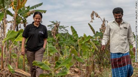 Krithi Karanth, left, helps rural communities access compensation for wildlife damage.