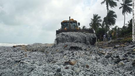 On May 28, an Earthmover X-Press removes debris from a ship on the beach of Pamunugama in Negombo, Sri Lanka.